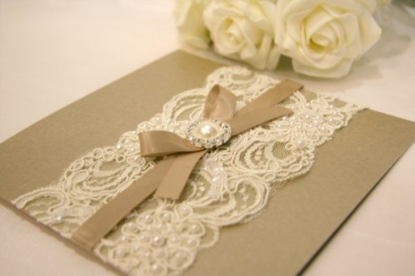 Vintage Wedding Invitation. I like the silk texture bow and the lace combination. Perhaps there is a way to corporate a design element that can give this feel without looking cheesy?