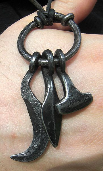 Amulet ring with Frey's sickle, Odin's spear, and Thor's hammer worn by a Swedish practitioner of Forn Sed. The style is typical of finds from Uppland and Södermanland, Sweden.