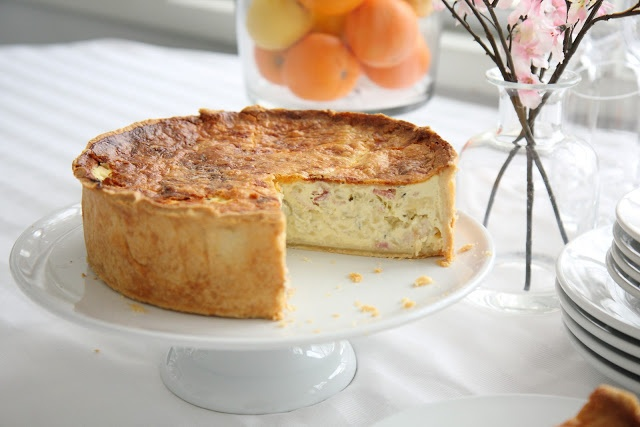 Quiche Lorraine | 2 cups flour, ½ teaspoon salt, 225gr butter, ¼ cup water, 1kg onions, 100gr butter, ¼ cup water, 2 bay leaves,  ½ kg slab bacon, 1 tablespoon fresh thyme, 1 cup cheese (Comté, Emmentaler or  Gruyère), 2 cups milk, 2 cups heavy cream, 6 eggs, Salt, Freshly ground black pepper, Freshly grated nutmeg.