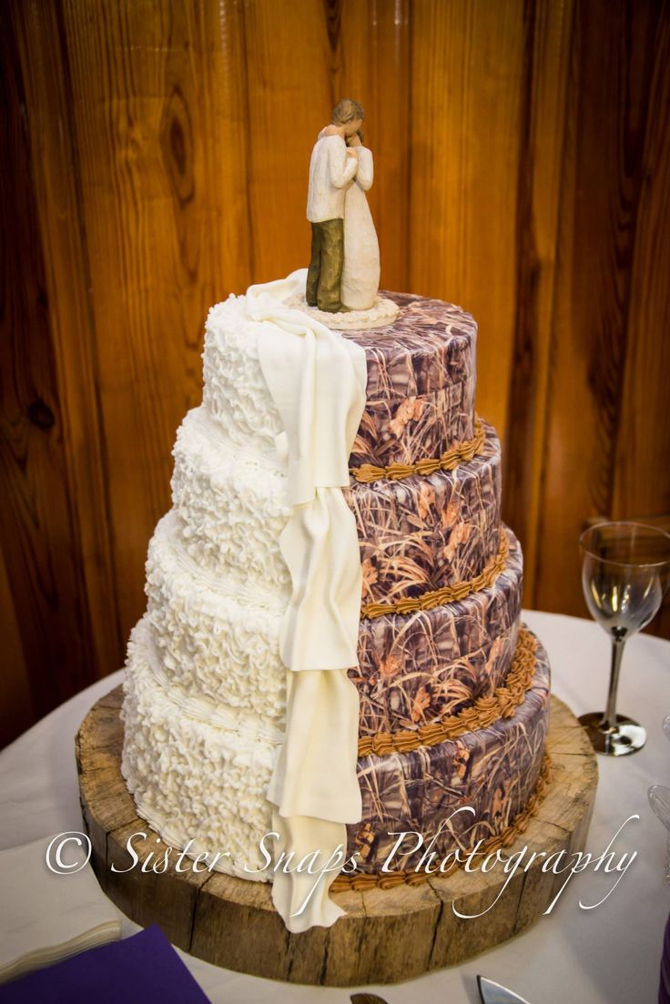 Wedding Cake thanks to We Girls Cake in Ayden, NC.... Not a big fan of the camo but interested in the place that made it