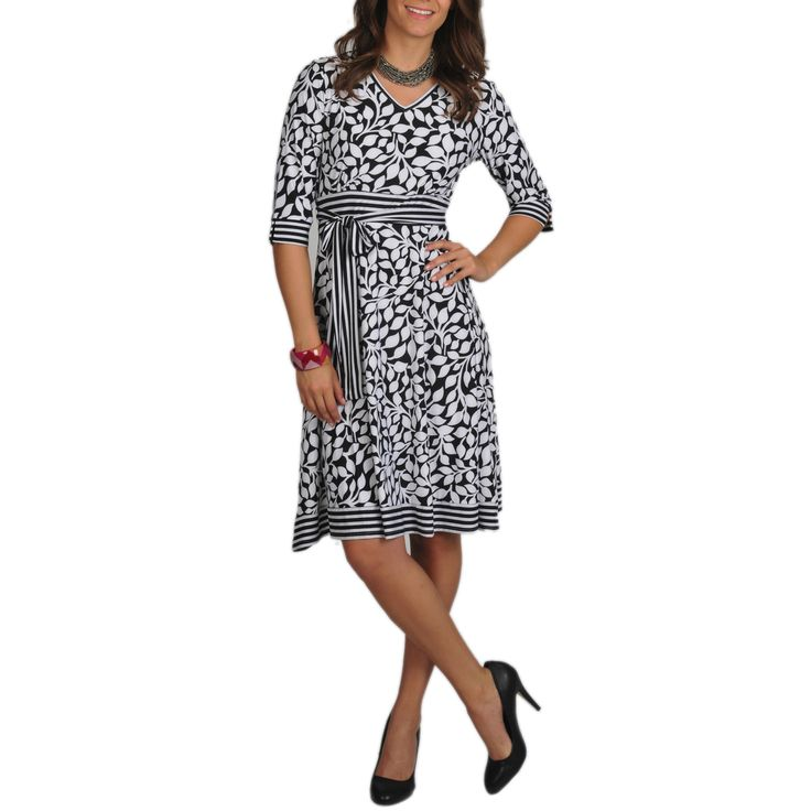 This cute dress by La Cera features a chic leaf print set off by bold striped trim. This dress has 3/4-length sleeves, a V-neck and is completed with a self-tied belt at the waist.