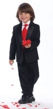If you post a picture of your little boy in any of our toddler tuxedos on our Facebook page, we will send you a $5 coupon code good for your next purchase.   Our toddler tuxedos come in white or black and offer a variety of colored vests to go right along with your toddler tuxedo. Your little boy will look so handsome at any wedding, christening, event or special occasion that calls for it.