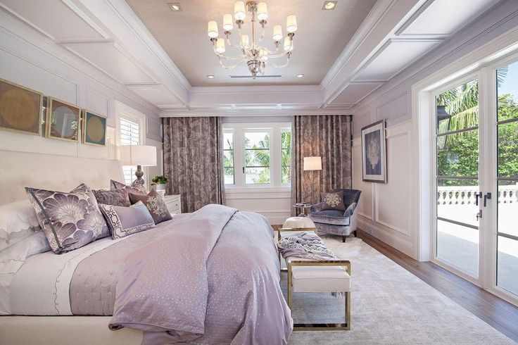 Spacious Master Bedroom With French Doors And Wainscoting