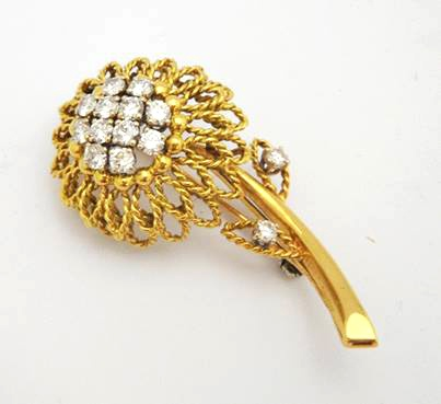 A lovely Cartier Flower Brooch from Anthea AG Antiques.