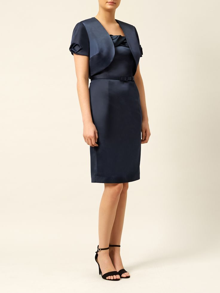 Wow dress now reduced to €65 and bolero now just €49!!  In French navy satin, this shift dress falls to just below the knee. It features twist pleat detailing at the neckline, a self-covered slider belt and a back vent to give a flattering finish to any figure €199, with matching bolero €119.