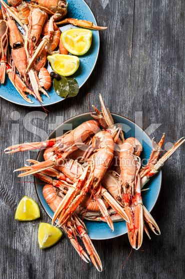 Fresh scampi served with lemon royalty-free stock photo