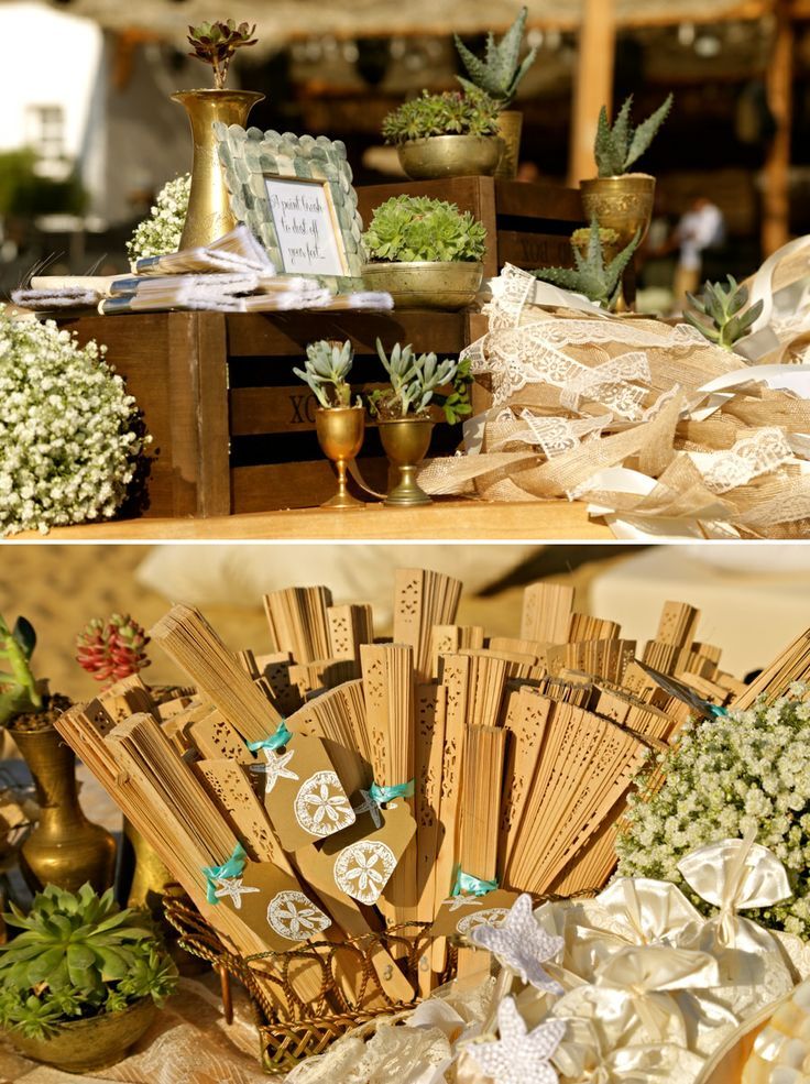 Details of the wedding table!The highlight...Wooden blowers for a sunny warm day at the beach!