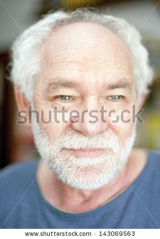 Caucasian man with blue eyes and white berad smiling by Adriano Castelli, via ShutterStock