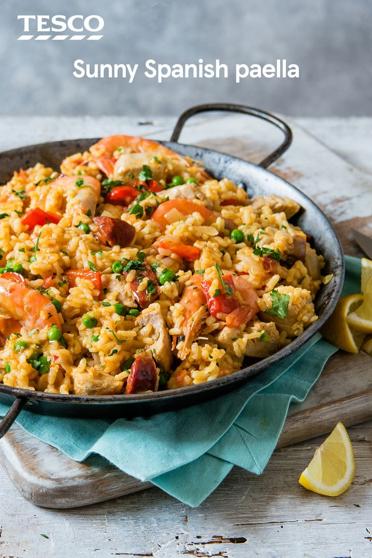 Cook up some Spanish sunshine with our classic paella recipe. Packed with chorizo, chicken, prawns and veg, this simple recipe gets it's vibrant colour from sweet saffron and smoky paprika. | Tesco