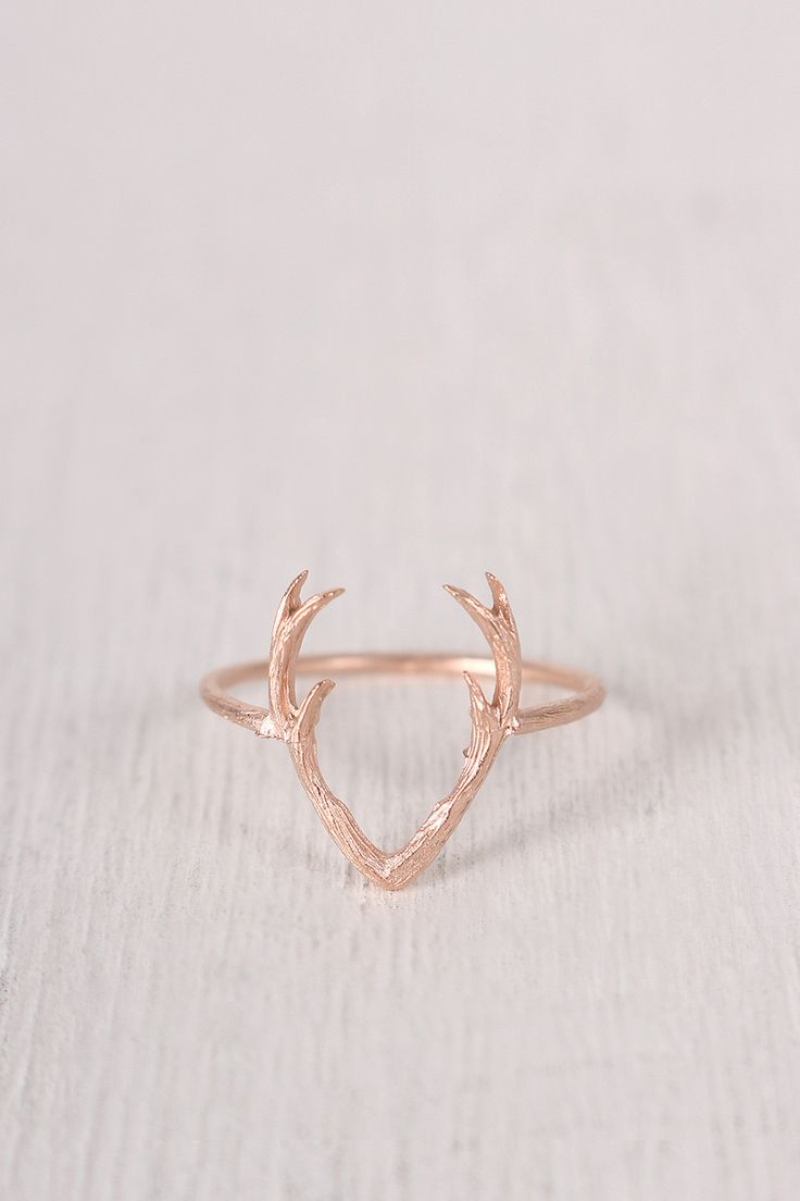 "This dainty ring features a textured brushed metal, thin band, with a small open antler design. Non adjustable band. Measurement Measures approx. 0.6"" L x 0.75"" D."