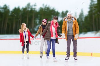 friends holding hands on outdoor skating rink