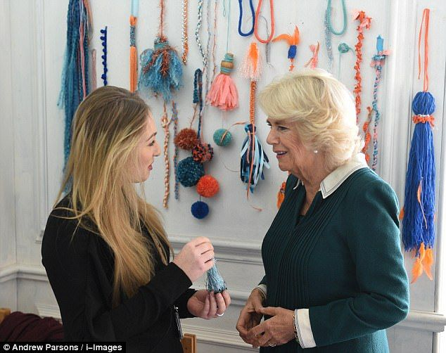 Camilla (pictured with a student) joked that she would be leaving the embroidery 'to the e...