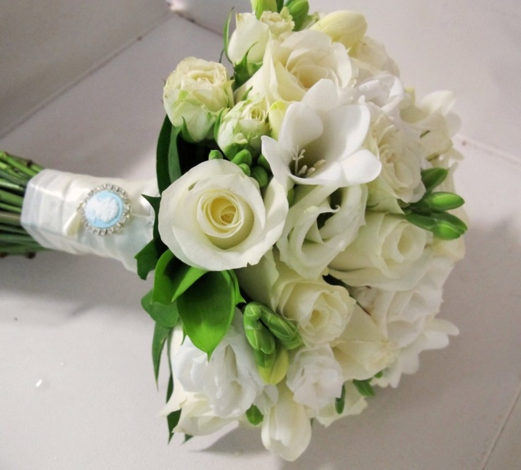 This bridal bouquet, designed by Sweet Floral is made up of White Roses, White Lissianthus and White Freesia's.