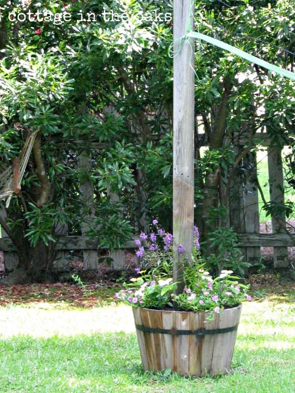 Make backyard sport equipment more homey.  Large flower containers can hold poles for a volleyball net.
