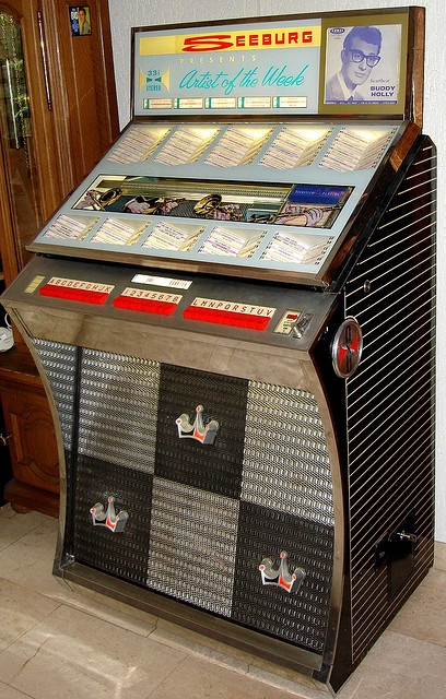 Seeburg Jukebox. I grew up with this exact model and loved it to pieces. Must find one.