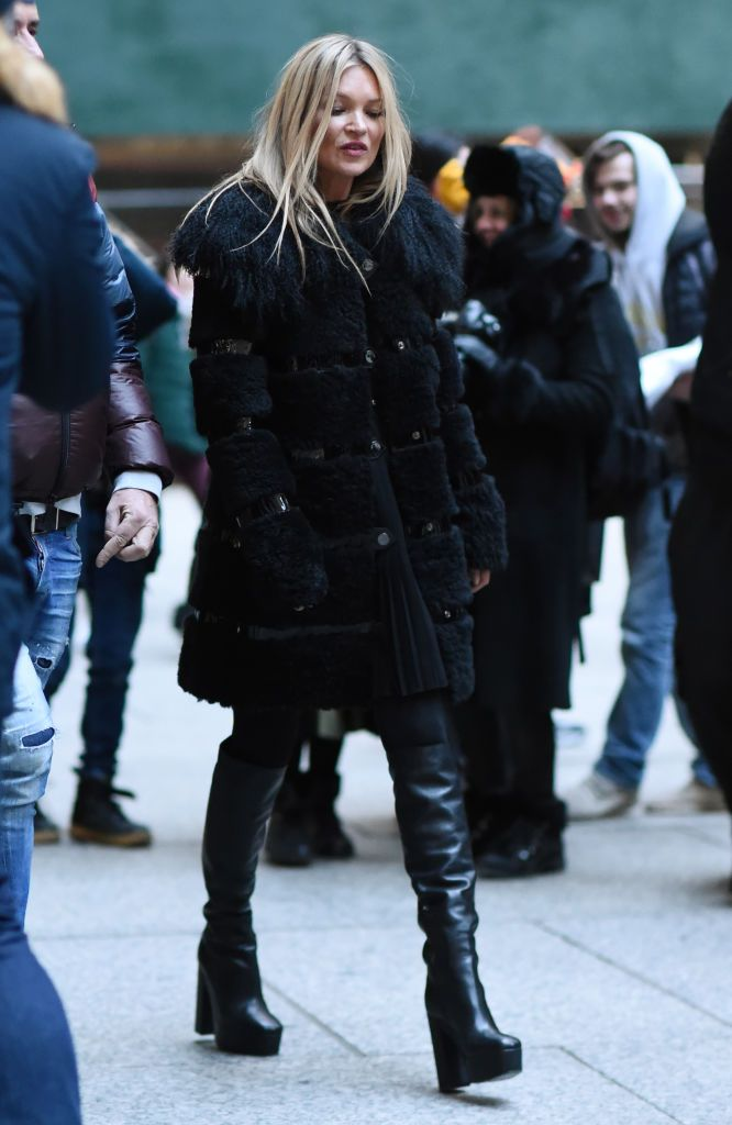 Kate Moss is seen wearing a black fur coat and black leather