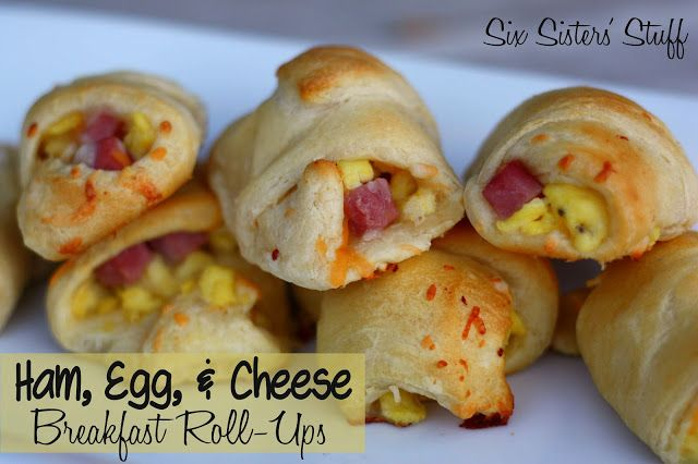 Ham, Egg, and Cheese Breakfast Roll-Ups- perfect for breakfast on the go! SixSistersStuff.com #breakfast #recipe