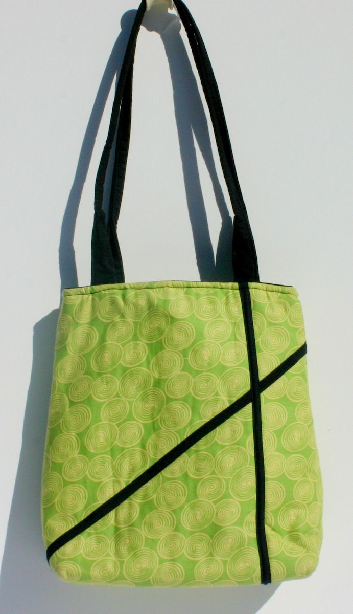 Light green cotton with black accents handbag. Lined in black cotton. 26 x 32 x 10 cm $40