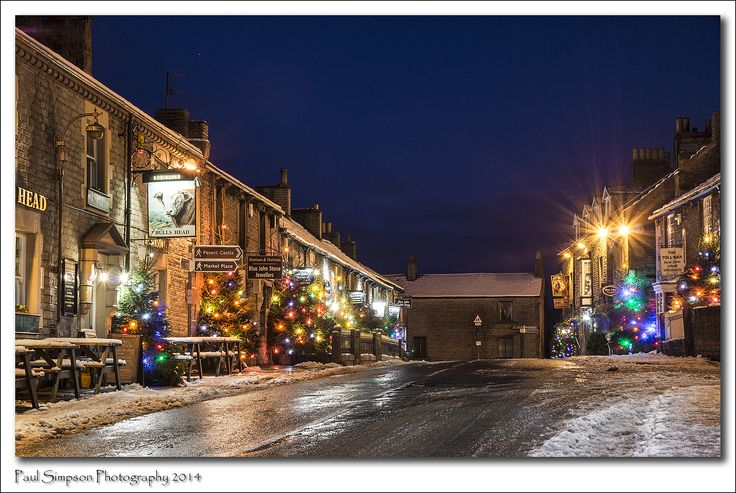 https://flic.kr/p/qjH2Ji   Castleton, Derbyshire   Looking up the main street of the village of Castleton, nestled in the Hope Valley in the Derbyshire Peak District. Each December the village is festooned with Xmas trees as all the pubs, shops and homes add some colour to this pretty little tourist village. This image was taken on the day after boxing day 2014 - just after a night of snowfall