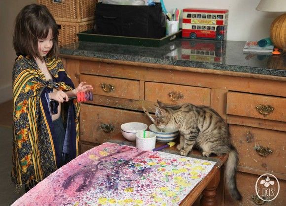 Iris Grace, an extraordinarily talented child with autism (and her cat).