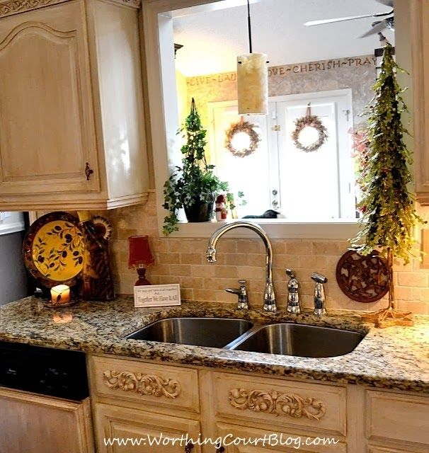 DIY French Country Kitchen Makeover:  appliques added to faux drawer fronts