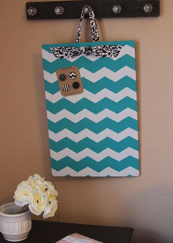Magnetic Board, Bulletin board, Magnet Board, Magnetic Bulletin Board, Fabric Bulletin Board, Chevron Bulletin Board, Girls Room, 12x18, Command Center, Chevron Magnet Board, Teal and Black, Wall decor, Teen Girls room decor  Type-Magnetic bulletin board Size-12 x 18 Hanging direction-choose vertical or horizontal Fabric-Teal chevron Ribbon-black floral Magnets-fabric covered button magnets  If you prefer vintage style button magnets please leave a note at checkout.  This is an elegant and…