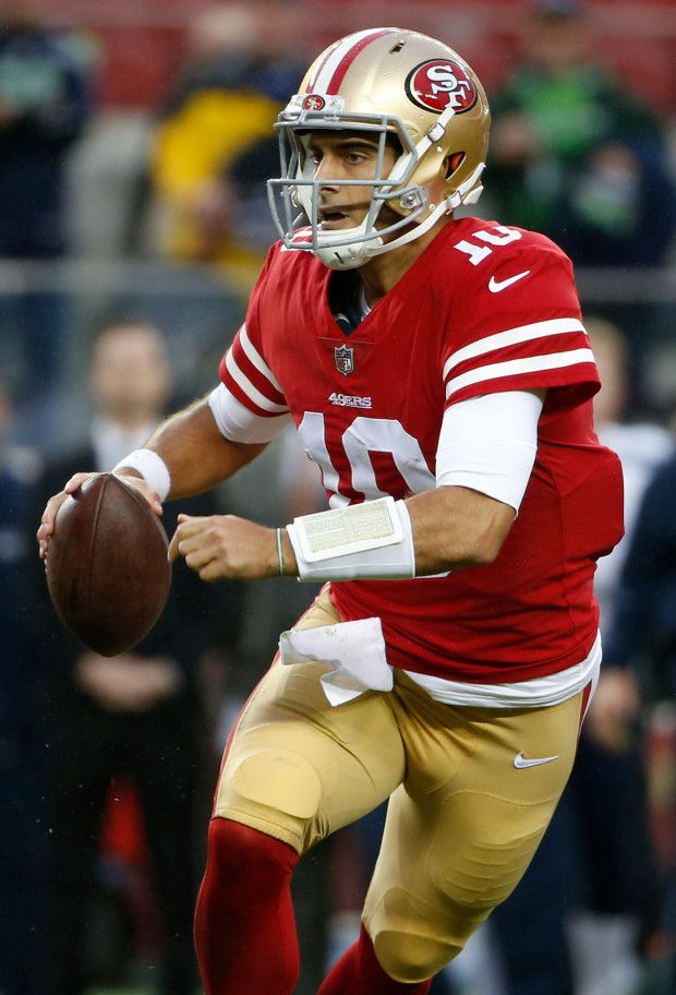 San Francisco 49ers quarterback Jimmy Garoppolo (10) rolls out looking for wide receiver Louis Murphy (18) on a fourth quarter touchdown against the Seattle Seahawks in an NFL game at Levi's Stadium in Santa Clara, Calif., Sunday, November 26, 2017. (Karl Mondon/Bay Area News Group)