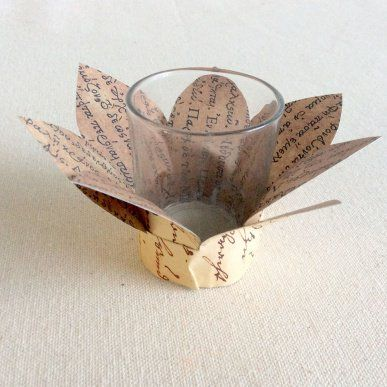 Books Light up our world.  This Book Page Flower Glass Tealight Holder is easy to make and looks stunning - CleverPatch