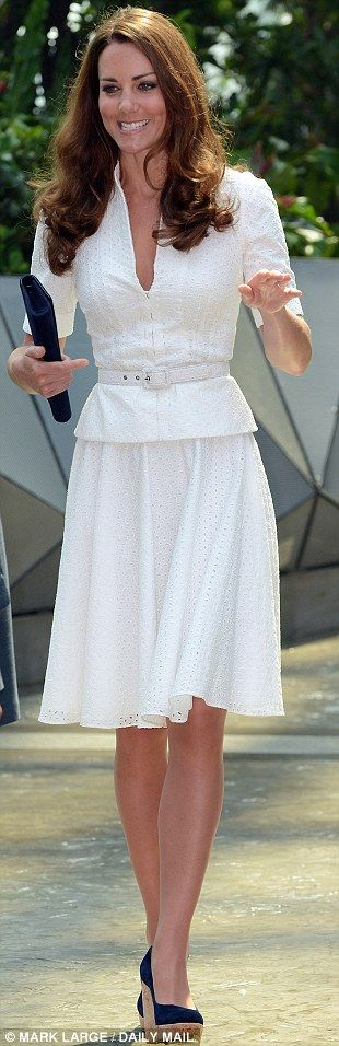 All white: Looking lovely in a £1,300 Anglaise suit by Alexander McQueen, with £245 Coco wedges (sister Pippa also owns a pair) and matching £245 clutch, both from Russell & Bromley