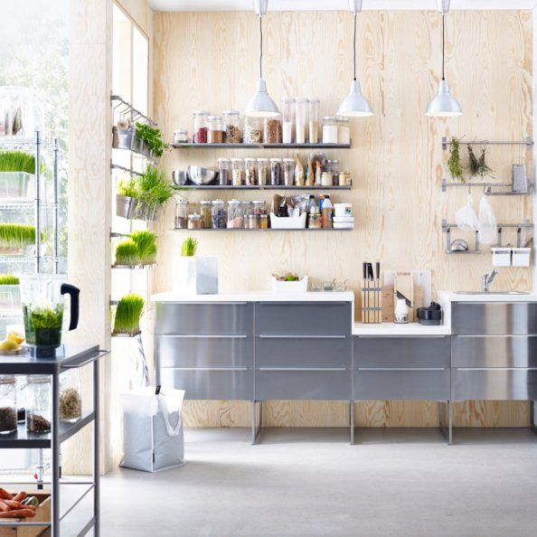 Create a beautiful and modern contrast with stainless steel RUBRIK drawers, wood and greenery