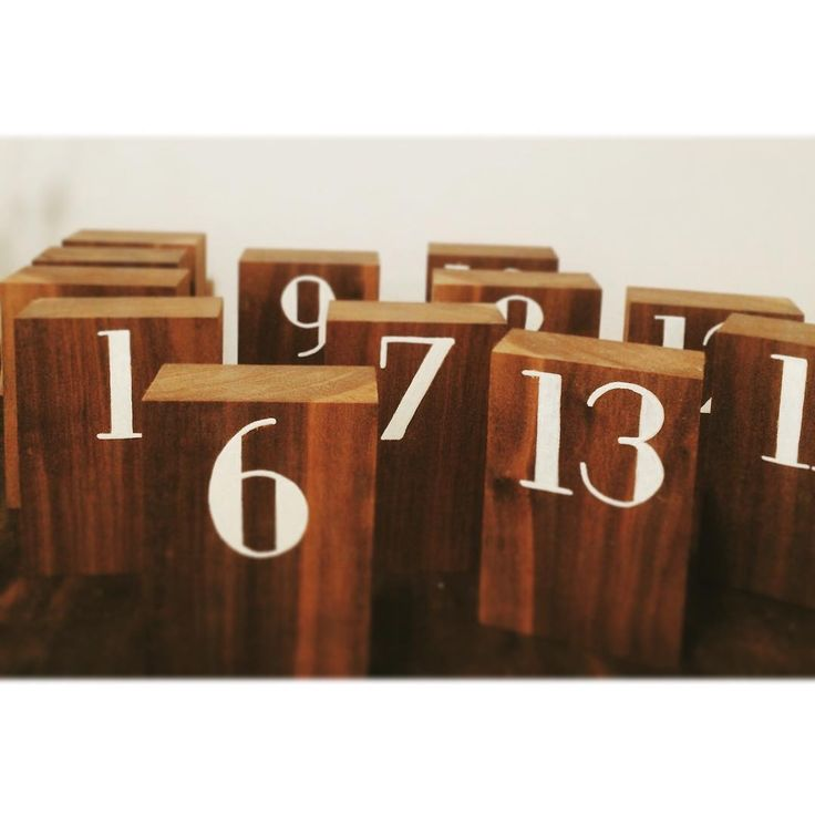 Hand-painted black walnut table numbers be making me swoon! #neatrentals #yegwedding #yegevents #blackwalnut #paintedtype