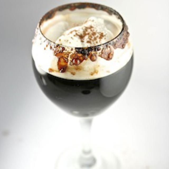 An image of a Flaming Spanish Coffee Cocktail topped with whipped cream, cinnamon and nutmeg. - Marko Goodwin