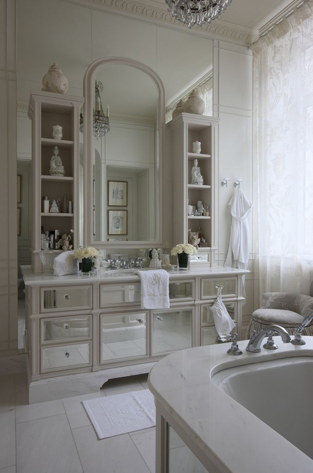 Lovely bathroom! Use a beautiful dresser and mirror as a vanity. Add small bookshelves and paint all to match and look built in.