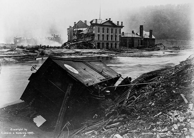 The Johnstown Flood. A freight car lies near the damaged Cambria Iron Works warehouse. 1889 [::SemAp Twitter || SemAp::]