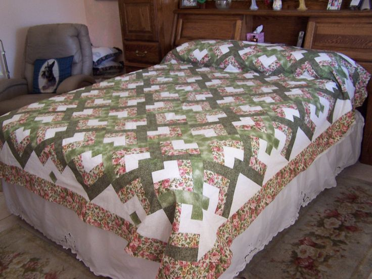 Lover's Knot Quilt.  I used this pattern for a quilt for Rick & Amie as their wedding gift.  OK, it was not done for the wedding but they got the idea.  A modified log cabin bock makes it easy to put together.