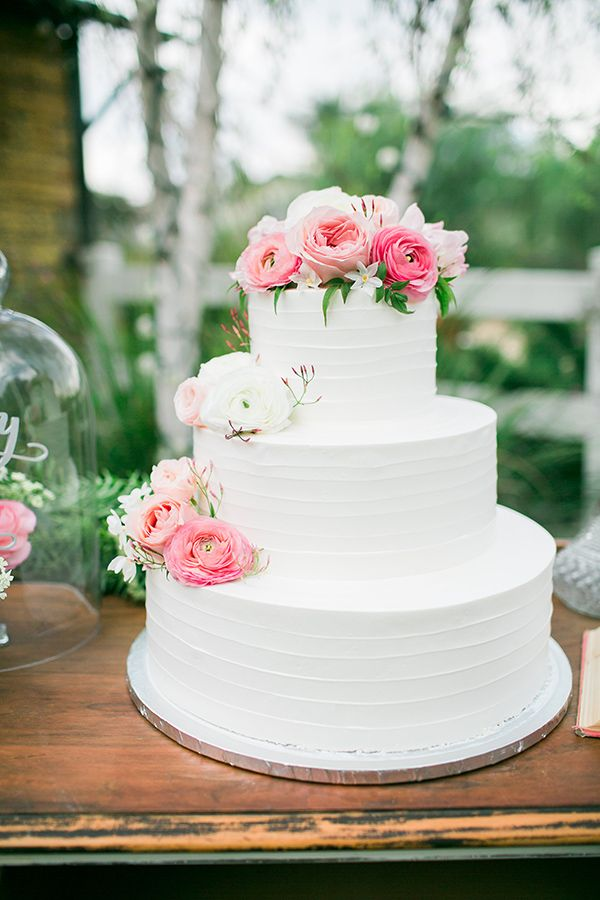 3 tier white wedding cake with pink flowers