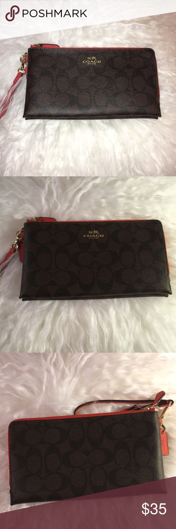 Double coach clutch Super cool double coach clutch with red zipper. Also wrist loop. Never worn. Coach Bags