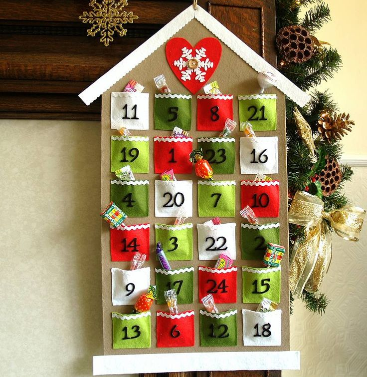 This handmade advent calendar is made using coloured felt, ric rac ribbon and finished off with a wooden button. it features pockets for a chocolate or a small gift. Size: 61.5cm x 38cm approx.
