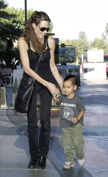 FILE PHOTO dated Sunday July 31 2005. FILE: HAND-ME-DOWN?Despite their vast wealth it appears Angelina Jolie and Brad Pitt's kids still wear hand-me-down clothes. Shiloh Jolie-Pitt, 5, showed off her edgy rocker style in New Orleans on March 7. Though she wore her own camouflage pants and yellow sneakers, Shiloh also donned a hand-me-down Ramones tee from Maddox, who was pictured wearing the shirt in 2005. ORIGINAL CAPTION: Angelina Jolie with her son Maddox go shopping at a 'Toys R Us where…