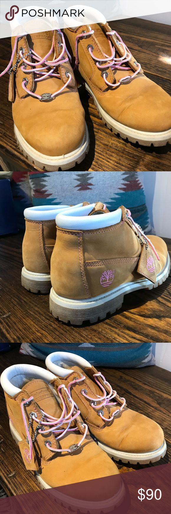 Timberland waterproof boots women's sz 7.5 Timberland waterproof boots women's sz 7.5. Wheat color with pink laces as pictured. Ask any questions prior to purchasing. I ship fast! Timberland Shoes Ankle Boots & Booties