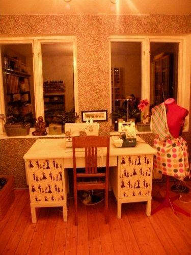 My re-decorated sewing table - I painted an old, dark desk and did some decoupage on the doors, using a beautiful sheet of paper with 1950's fashion. /Sara Waters 2015