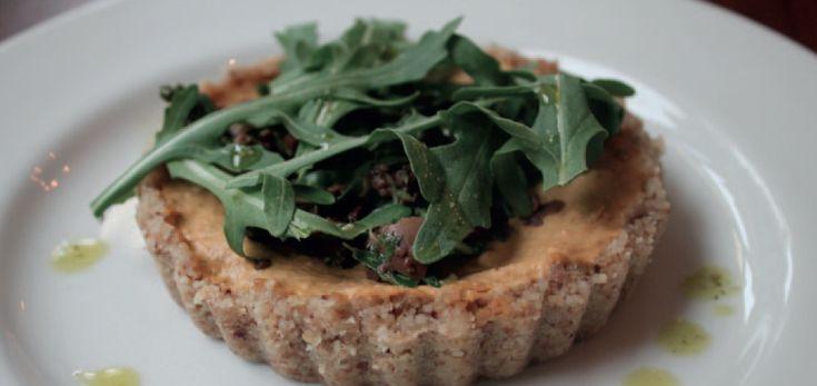 Raw vegan sundried tomato, olive, and spinach tart. A Cornucopia recipe.