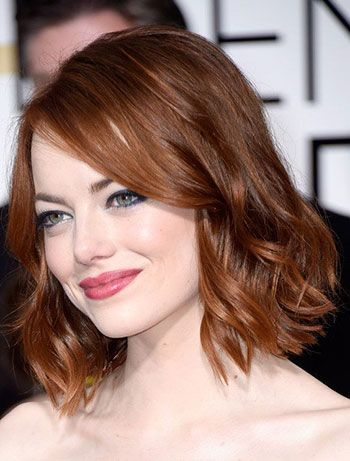 """Ronze - A striking combination of red and bronze tones """"Ronde"""" is another color name mashup that's bound to get many requests in 2016. This deep copper and warm brown hair color is best suited for warm to golden skin tones, like actress Emma Stone."""
