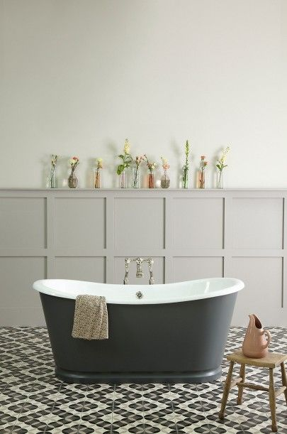 Grey paneling, navy tub, tiled floor
