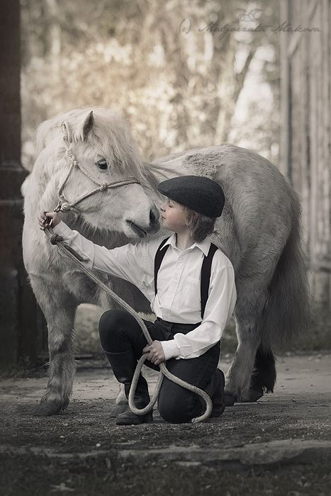 Mini horse and young boy.