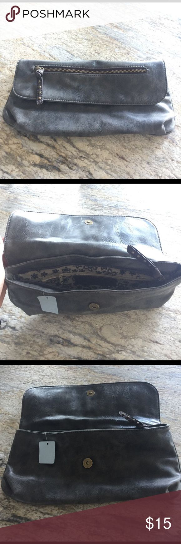 Faux leather grey clutch Faux leather dark grey clutch w/snap closure. Zippered inside pocket. Bags Clutches & Wristlets