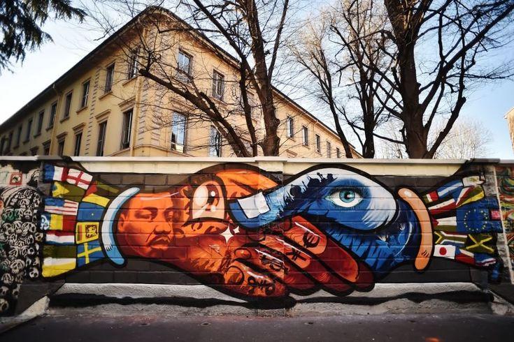 Un muro pieno di colori per via Padova a Milano. Il progetto 'Tutto il mondo sulle mura del liceo' del liceo artistico Caravaggio si è concluso con la decorazione di una lunga parete tra via Padova e via Prinetti, a Milano, da parte degli studenti che hanno hanno lavorato nel fine settimana a