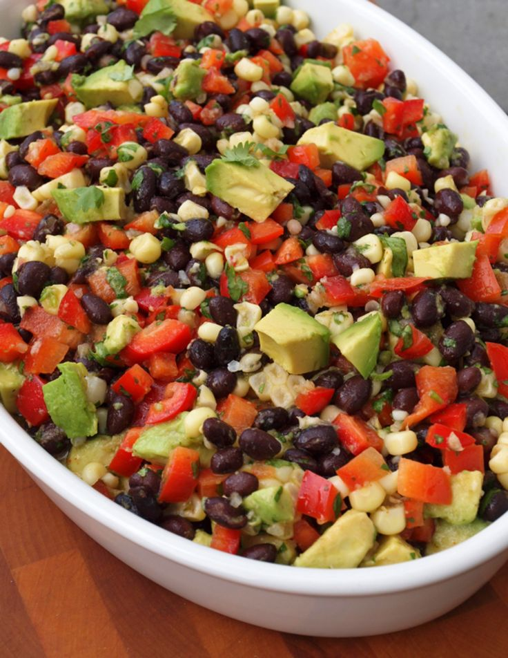 "This Mexican-inspired salad made with black beans, corn, red peppers and avocado in a lime cilantro vinaigrette is often referred to as ""veggie crack"" because it so addictive. Try this version as well! http://www.themom100.com/recipe/southwest-black-bean-and-corn-salad/"