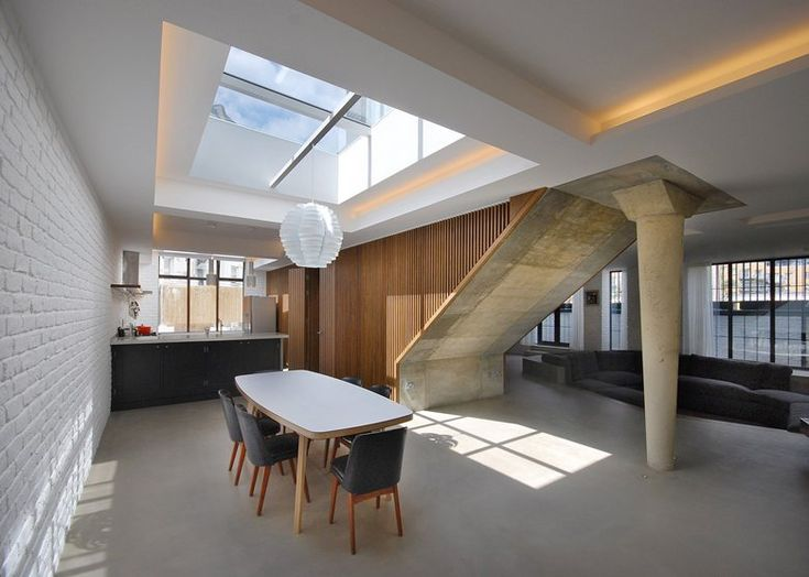 These existing buildings have been radically transformed by completely rethinking the internal configuration, punching larger openings through the building envelope and introducing private courtyards. This draws natural light deep into the floor...