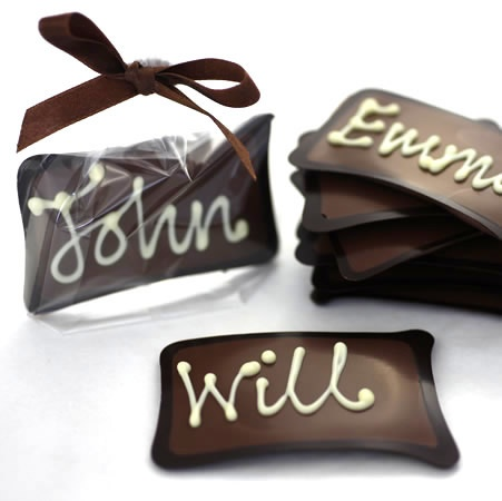 Milk chocolate place settings with dark chocolate edge and white chocolate hand piped name